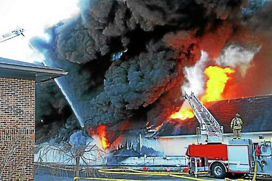The scene of a five-alarm fire at the Toce Brothers Inc. tire warehouse Thursday morning in Torrington. Esteban L. Hernandez ó Register Citizen Photo: Journal Register Co.
