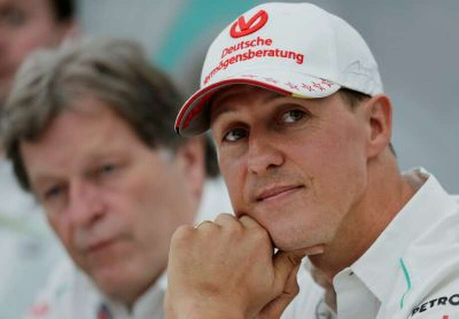 "FILE - This is a Thursday, Oct. 4, 2012 file photo of  Mercedes driver Michael Schumacher, right, of Germany sits with teammate Norbert Haug,  during a news conference to announce his retirement from Formula One at the end of the 2012  in Suzuka, Japan.  Michael Schumacher's manager said Friday April 4, 2014 that the retired Formula One star now ""shows moments of consciousness and awakening,"" more than three months after suffering serious head injuries in a skiing accident. Manager Sabine Kehm said in a statement that ""Michael is making progress on his way."" She added that ""we keep remaining confident."" (AP Photo/Shizuo Kambayashi, File) Photo: AP / AP"