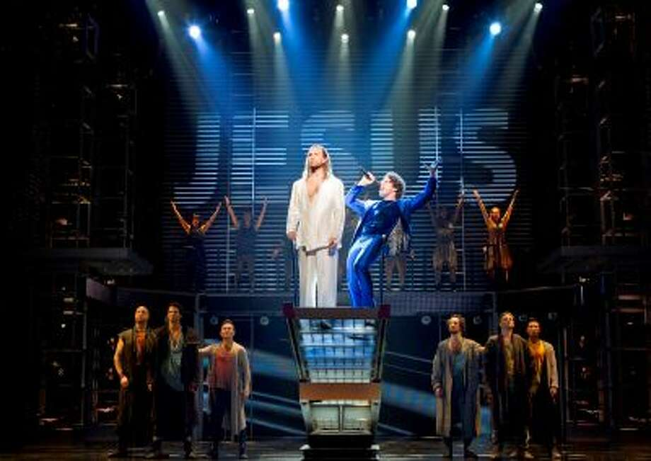 """In this theater publicity image released by Boneau/Bryan-Brown, Paul Nolan, center left, and Josh Nolan are shown with the cast during a performance of """"Jesus Christ Superstar,"""" in New York. (AP Photo/Boneau/Bryan-Brown, Joan Marcus) Photo: AP / Boneau/Bryan-Brown"""