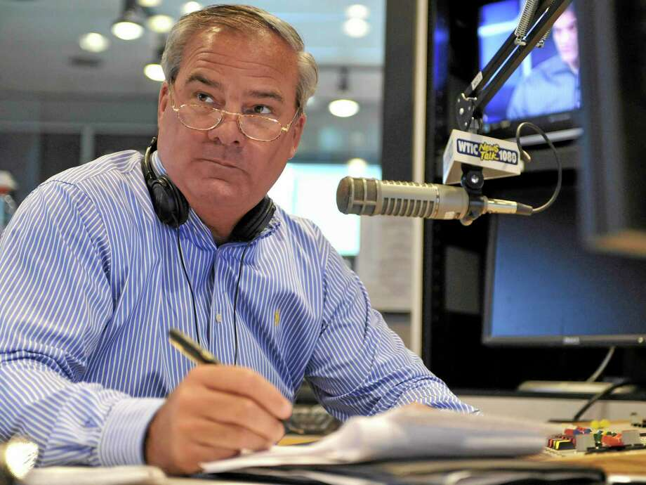 FILE - In this July 2, 2010 file photo, former Connecticut Gov. John Rowland sits in studio as a talk show host on WTIC AM radio in Farmington, Conn. Rowland resigned from office in 2004 amid a corruption scandal. He eventually was sentenced to serve time in a federal prison, but again is in the crosshairs of federal investigators. On Monday, March 31, 2014, a former Republican Congressional candidate and her husband pleaded guilty in a scheme to create a phony contract to hide the consulting role Rowland played in her campaign. (AP Photo/Jessica Hill, File) Photo: AP / FR125654 AP