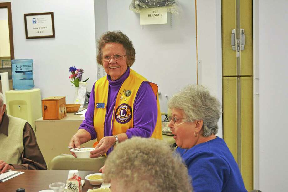 Blanche McCarthy Sewell, Lions Club member serves lunch to Lucy Peck at the Winsted Senior Center Friday afternoon as part of the Winsted Lion's celebration of World Wide Relay day. Photo: Jenny Golfin - The Register Citizen