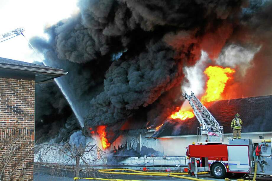 The scene of a five-alarm fire at the Toce Brothers Inc. tire warehouse Thursday morning in Torrington. Photo: Esteban L. Hernandez — Register Citizen