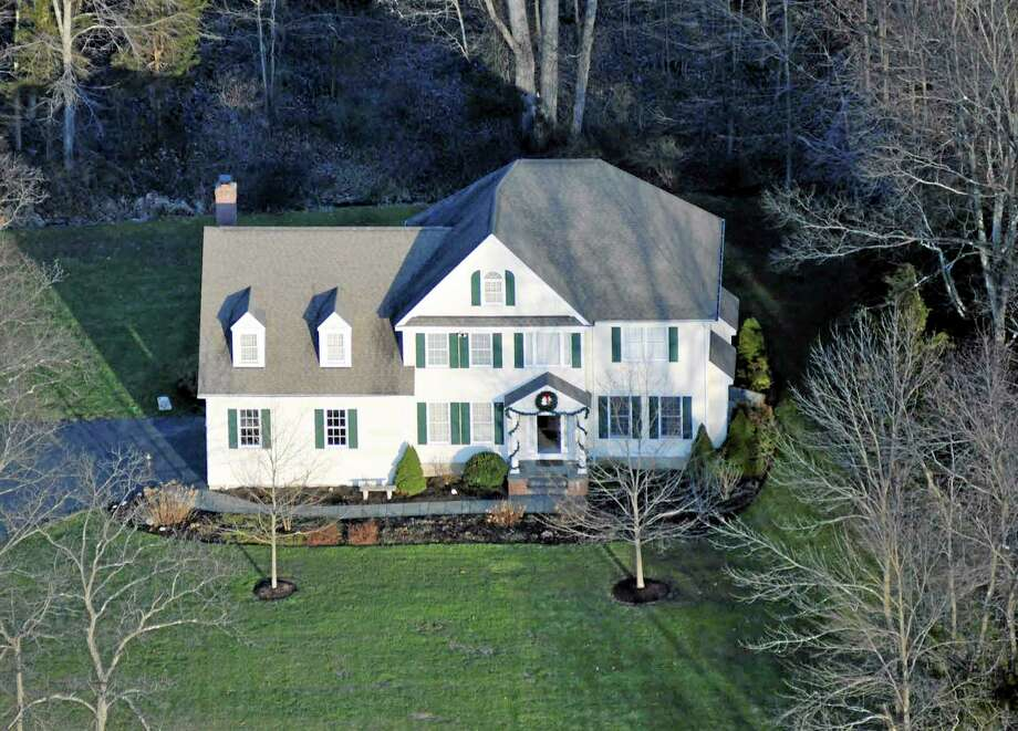 This photo released by Connecticut State Police on Friday, Dec. 27, 2013 shows an aerial view of the home where Adam Lanza lived with his mother in Newtown, Conn. Lanza gunned down 20 first-graders and six educators with a semi-automatic rifle at Sandy Hook Elementary School on Dec. 14, 2012, in Newtown, after killing his mother inside their home. Lanza committed suicide with a handgun as police arrived at the school. (AP Photo/Connecticut State Police) Photo: AP / Connecticut State Police