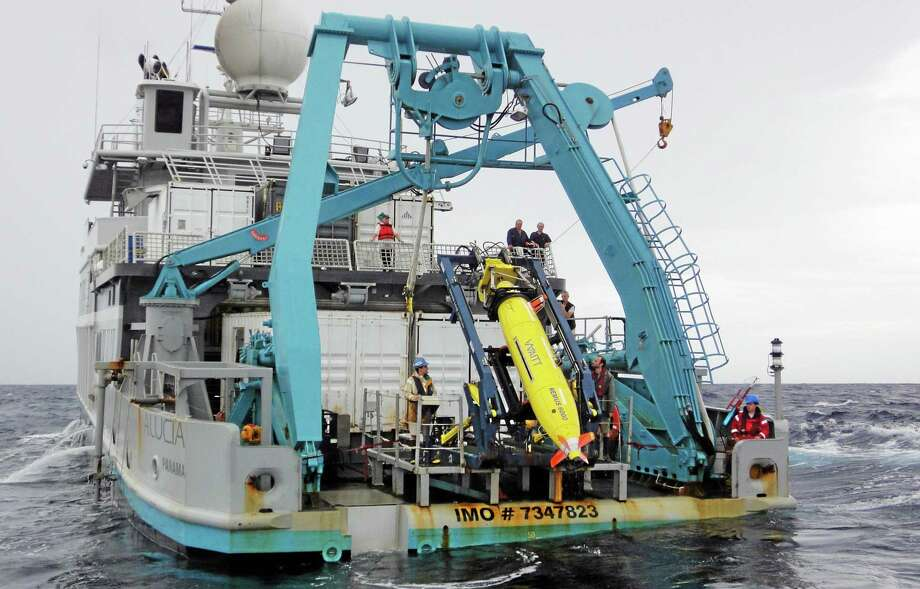 This 2011 photo provided by Sylvain Pascaud shows the ship Alucia and the REMUS 6000 robot sub during the search for Air France Flight 447. Unmanned subs, also called autonomous underwater vehicles or AUVs, played a critical role in locating the wreckage of the lost Air France jet, two years after it crashed in the middle of the south Atlantic. The find allowed searchers to recover the black boxes that revealed the malfunctions behind the tragedy. (AP Photo/Sylvain Pascaud) Photo: AP / Sylvain Pascaud via Hydroid
