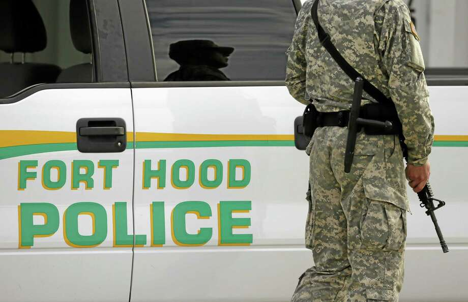 FILE PHOTO - A U.S. Army police officer stands patrol outside the the Lawrence H. Williams Judicial Center, Wednesday, Aug. 21, 2013, in Fort Hood, Texas. (AP Photo/Tony Gutierrez) Photo: AP / AP