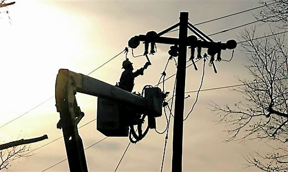 A Coast Electric Power Association lineman grounds a line on a replacement pole in McNeill, Miss., Wednesday, Dec. 26, 2012. (AP Photo/Rogelio V. Solis) Photo: AP / AP