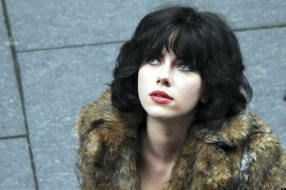 """This image released by A24 Films shows Scarlett Johansson in a scene from """"Under the Skin."""" (AP Photo/A24 Films) Photo: AP / A24 Films"""