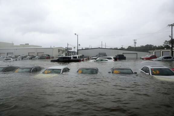 Vehicles are seen submerged at a dealership off Interstate 45 in Dickinson, Texas, Sunday, Aug. 27, 2017. (Kelsey Walling/The Galveston County Daily News via AP)