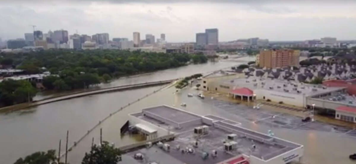Drone footage captured in the West U area of Houston Sunday, Aug. 27, morning show rising waters in the Brays Bayou and streets filled with water during Tropical Storm Harvey.