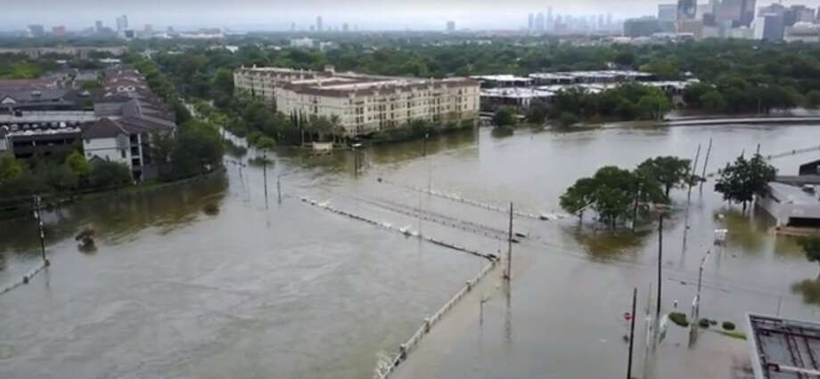 Drone footage captured in the West U area of Houston Sunday, Aug. 27, morning show rising waters in the Brays Bayou and streets filled with water during Tropical Storm Harvey. Photo: Ahmed Gul/ @ahmed.gul