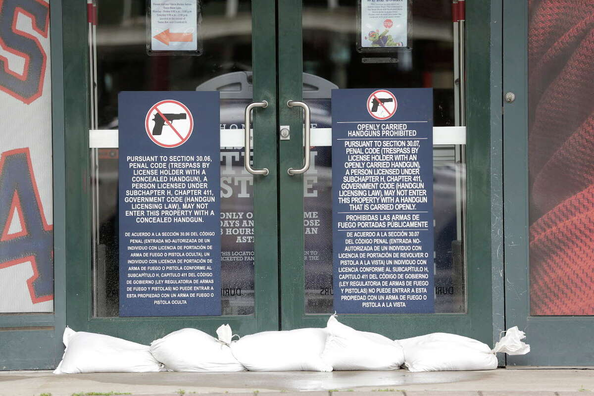 Sandbags line the doors to the Team Store at Minute Maid Park on Friday, Aug. 25, 2017, in Houston.