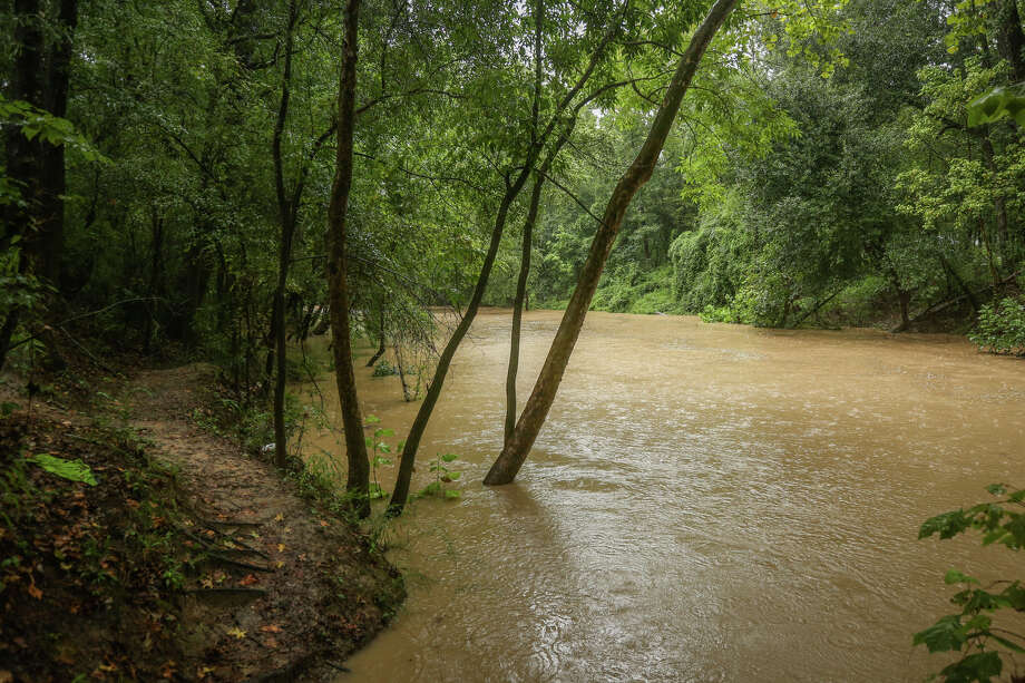 West Fork San Jacinto River, pictured near McDade Park, rises with rains from Hurricane Harvey on Saturday, Aug. 26, 2017, in Conroe. Photo: Michael Minasi, Staff Photographer / © 2017 Houston Chronicle