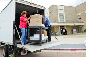 The South Texas Food Bank drops off donated food for the Hurricane Harvey evacuees at the James and Maria Luisa Hayes Recreation Center on Saturday, August 26, 2017.