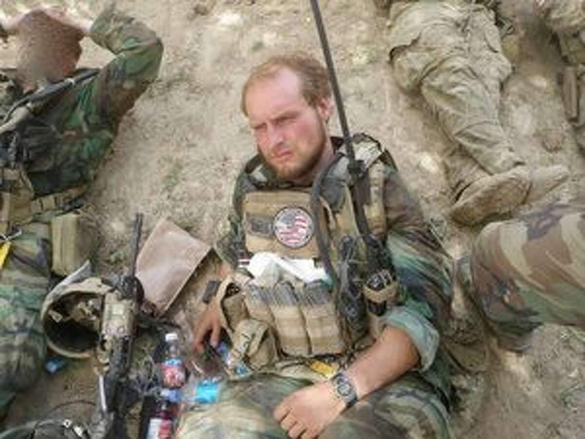 Courtesy of Staff Sgt. Kevin Flike Army Staff Sgt. Kevin Flike takes a break during an Afghanistan war mission.