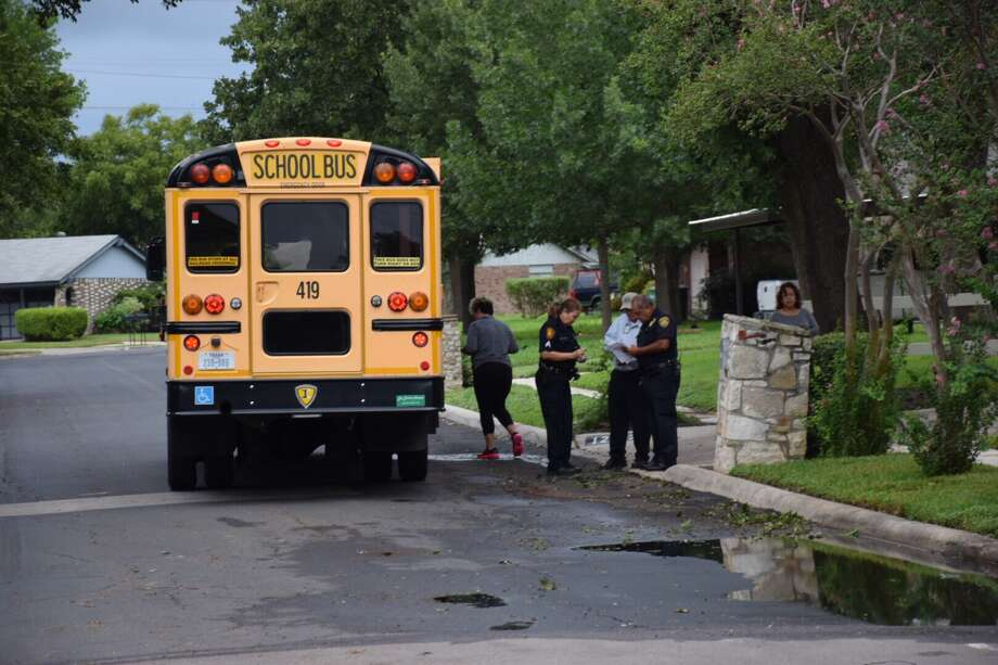 A North East ISD school bus pulled out in front of an SUV Monday morning, causing a minor crash. Photo: Caleb Downs / San Antonio Express-News