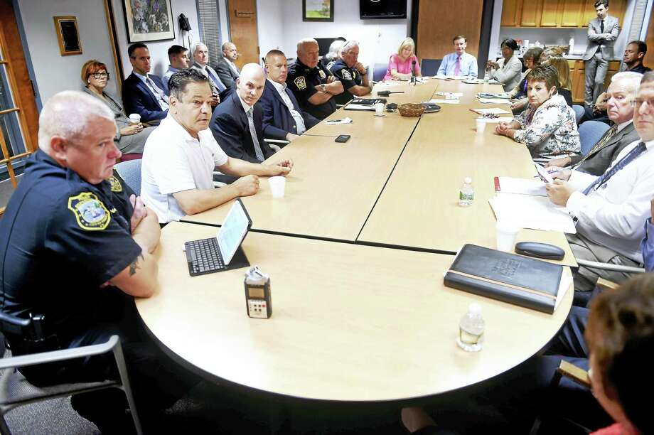 file photo Ansonia Mayor David Cassetti (second from left) speaks at a roundtable discussion about the opioid epidemic at BHcare in Ansonia on 7/29/2016.