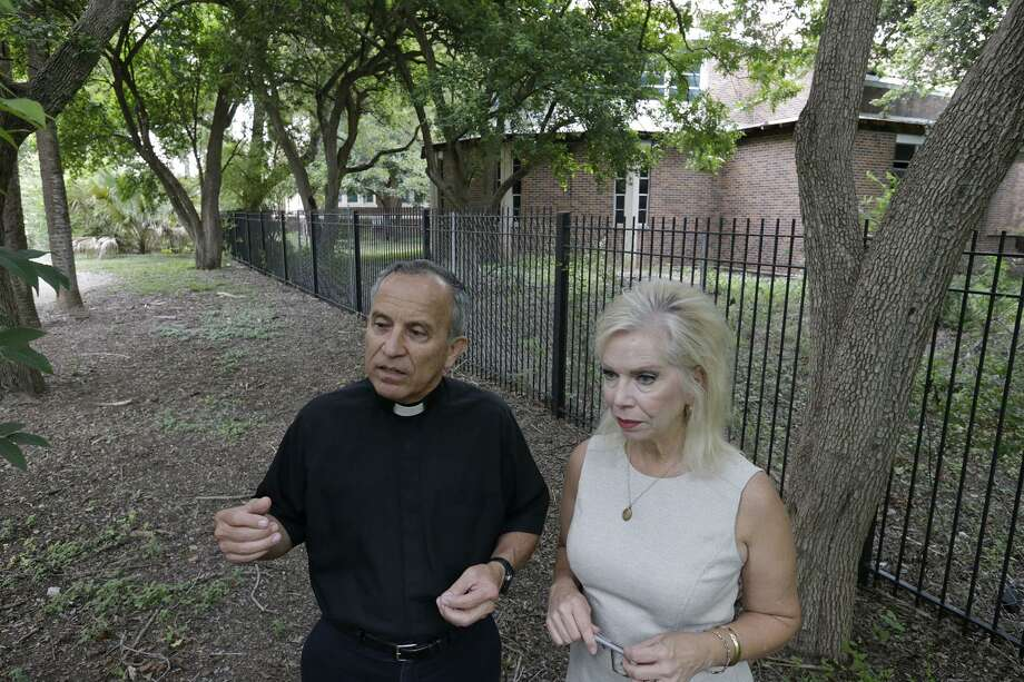 Father David Garcia (left) and Julie Seguin, director of the Archdiocese of San Antonio Office of Development talk about the former St. John's Seminary behind Mission Concepcion . Photo: Edward A. Ornelas / San Antonio Express-News / © 2017 San Antonio Express-News