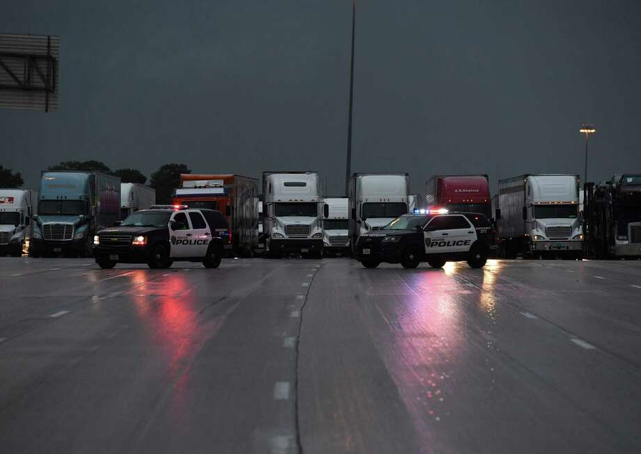 Photos: Tropical Storm Harvey floods Houston Police block traffic following closure of the I-10 freeway leading into Houston after Hurricane Harvey caused heavy flooding in Texas, August 27, 2017.See more images of the devastation caused by Tropical Storm Harvey. Photo: MARK RALSTON, AFP/Getty Images / AFP or licensors