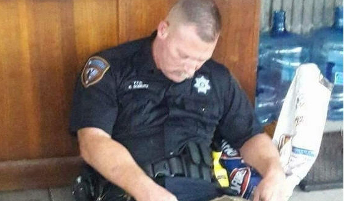 A photo of Harris County Deputy Sheriff Robert Goerlitz resting after helping Hurricane Harvey victims in Harris County on Aug. 27, 2017 has gone viral. See more images of flooding in Texas due to Hurricane Harvey.