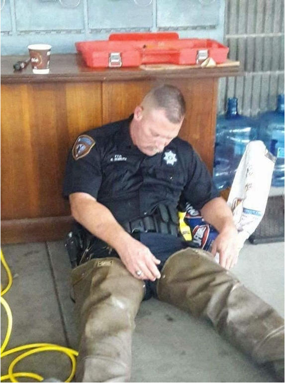 Photo of exhausted Harris County deputy sheriff after Hurricane Harvey rescue efforts goes viral