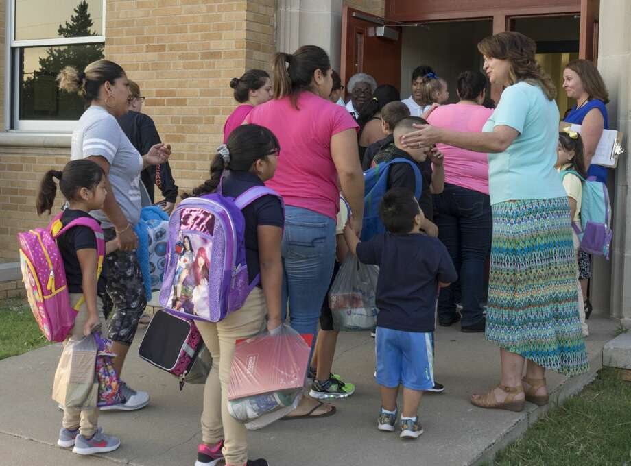 Teachers and administrators greet parents and students outside South Elementary 8/28/17 morning for the first day of school. Tim Fischer/Reporter-Telegram Photo: Tim Fischer/Midland Reporter-Telegram