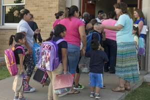 Teachers and administrators greet parents and students outside South Elementary 8/28/17 morning for the first day of school. Tim Fischer/Reporter-Telegram