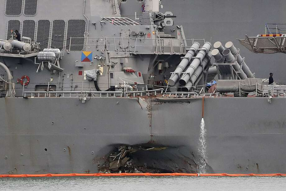 The hull of the John S. McCain shows damage from its collision Aug. 21 with an oil tanker in coastal waters off Singapore. Ten sailors were killed. Photo: Wong Maye-E, Associated Press