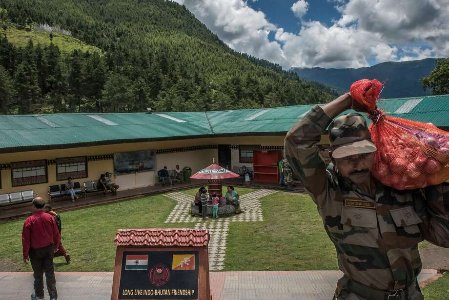 An Indian soldier carries food earlier this month at a facility in Bhutan near a disputed border area. Photo: GILLES SABRIE, NYT