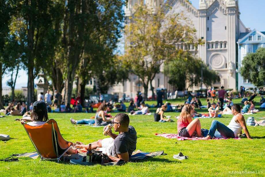 People enjoy the warm weather at Washington Square Park in San Francisco on Sunday, August 27th, 2017. (Instagram/@jgamell) Photo: Instagram / Jgamell