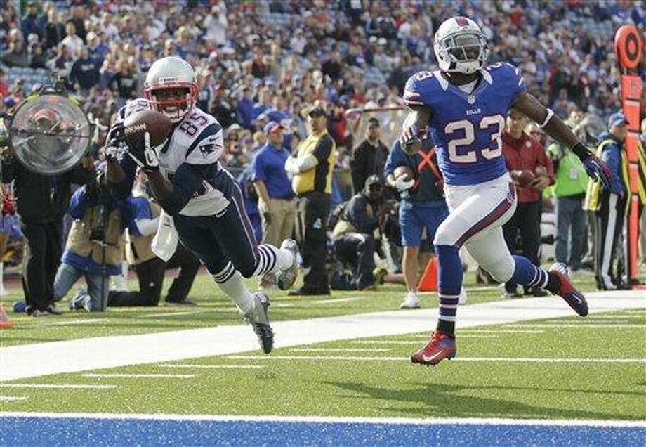 New England Patriots' Brandon Lloyd (85) makes a touchdown catch next to Buffalo Bills' Aaron Williams (23) during the second half of an NFL football game in Orchard Park, N.Y., Sunday, Sept. 30, 2012. (AP Photo/Gary Wiepert) Photo: ASSOCIATED PRESS / AP2012
