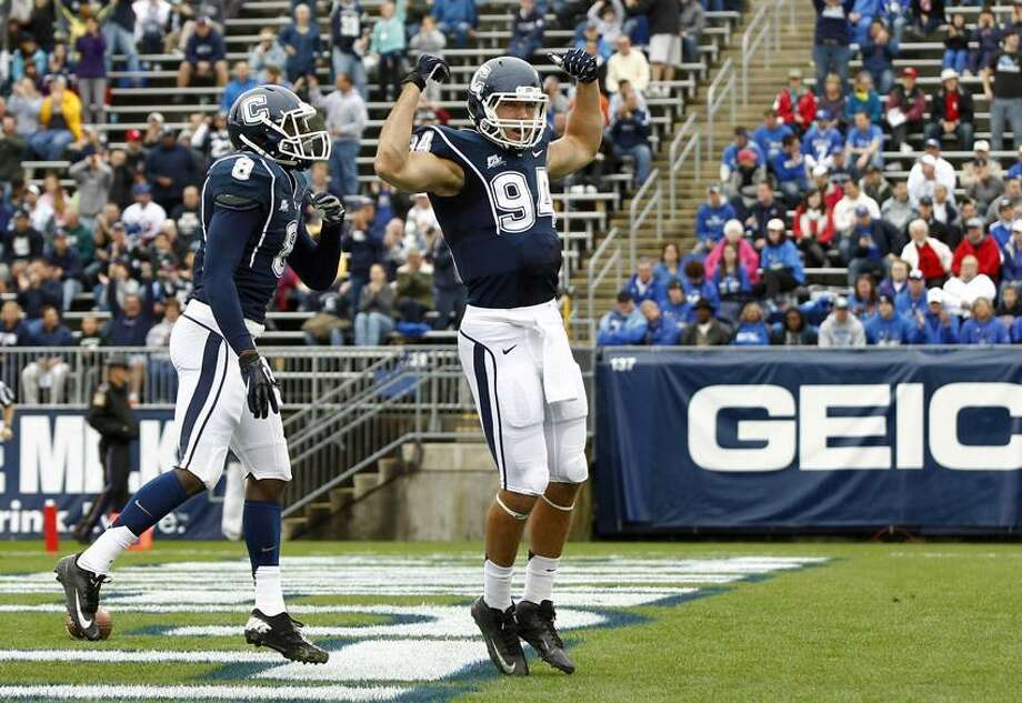 UConn tight end Ryan Griffin (94) celebrates his touchdown against Buffalo during the first half at Rentschler Field on Saturday. (Mark L. Baer-US PRESSWIRE) Photo: US PRESSWIRE / Mark L. Baer