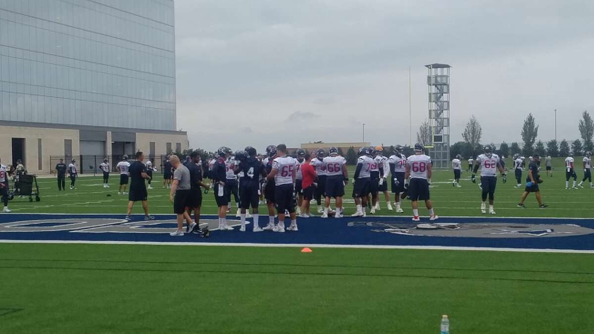 The Texans were forced to work out at the Dallas Cowboys' facility in Frisco on Monday after flooding in the Houston area from Hurricane Harvey.