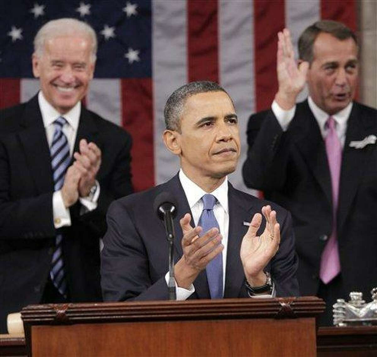 AP Obama joins Vice President Joe Biden, left, and Speaker of the House John Boehner, in applause before delivering his State of the Union address Tuesday night.