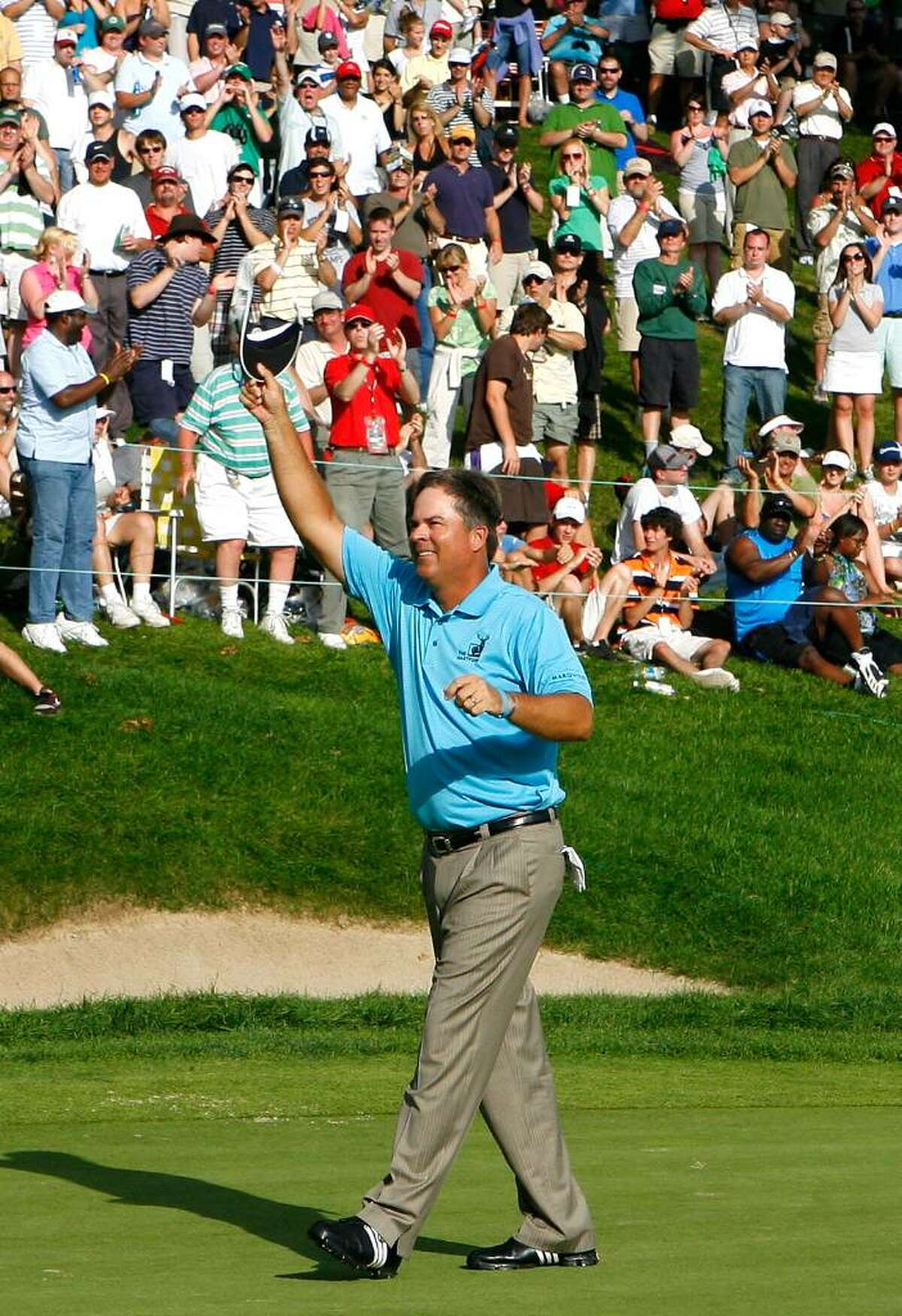 CROMWELL, CT - JUNE 28: Kenny Perry celebrates winning the 2009 Travelers Championship at TPC River Highlands on June 28, 2009 in Cromwell, Connecticut. (Photo by Jim Rogash/Getty Images) *** Local Caption *** Kenny Perry
