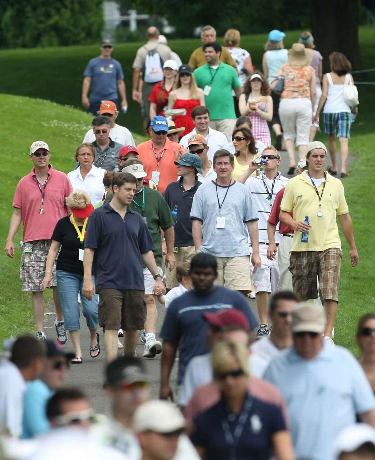 CROMWELL, CONNECTICUT - JUNE 27: Fans head to the first green during round three of the 2009 Travelers Championship at TPC River Highlands on June 27, 2009 in Cromwell, Connecticut. (Photo by Jim Rogash/Getty Images)