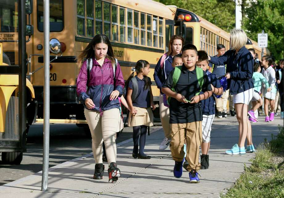 Students walk to John C. Daniels School of International Communications in New Haven on the first day of school on 8/28/2017.  Arnold Gold / Hearst Connecticut Media Photo: Arnold Gold, Hearst Connecticut Media / New Haven Register