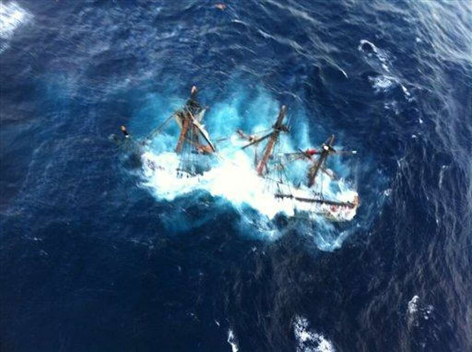 This photo provided by the U.S. Coast Guard shows the HMS Bounty, a 180-foot sailboat, submerged in the Atlantic Ocean during Hurricane Sandy approximately 90 miles southeast of Hatteras, N.C., Monday, Oct. 29, 2012. The Coast Guard rescued 14 of the 16 crew members by helicopter. Hours later, rescuers found one of the missing crew members, but she was unresponsive. They are still searching for the captain. (AP Photo/U.S. Coast Guard, Petty Officer 2nd Class Tim Kuklewski) Photo: ASSOCIATED PRESS / AP2012