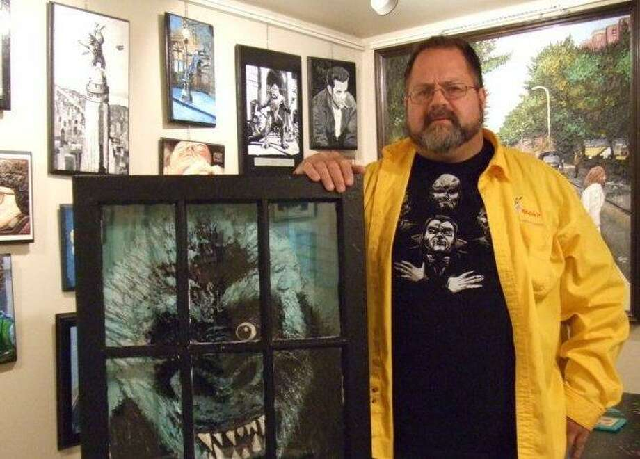 Artist of the Month Joe Kopler, in his gallery with King Kong. King Kong is on display and for sale this month at the Newsroom Cafe.