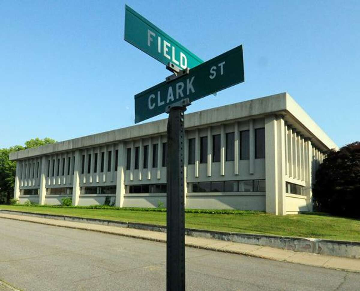 The now-vacant building at the corner of Clark and Fields streets in Torrington will be part of the proposed judicial complex. The building is slated to be renovated, while a new building is constructed on the site of the adjacent parking lot.