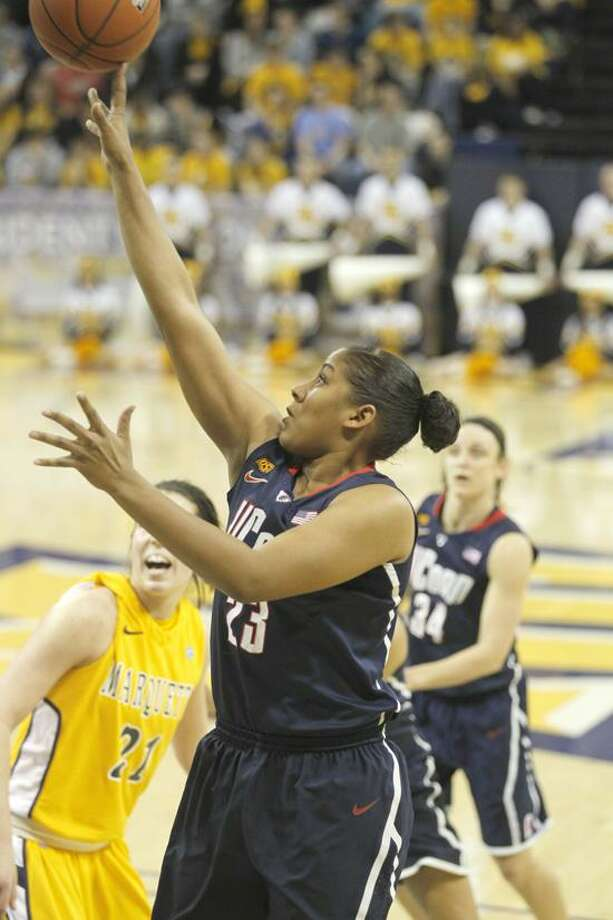 Connecticut's Kaleena Mosqueda-Lewis(23) puts up a shot against Marquette in the first half of an NCAA college basketball game Saturday, Feb. 25, 2012, in Milwaukee. (AP Photo/Jeffrey Phelps) Photo: AP / AP2012