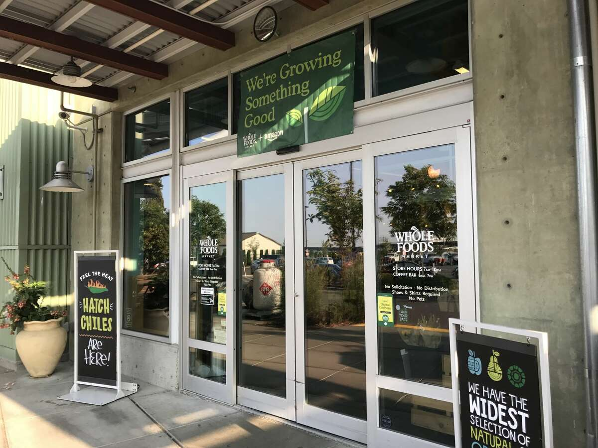 Seattle's Whole Foods Market location in Interbay unveiled lower prices on Monday, Aug. 28, 2017, the day the grocery chain's $13.7 billion purchase by Amazon became official.