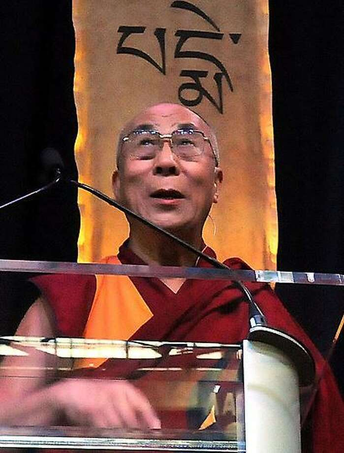 The Dalai Lama acknowledged the audience in the bleachers before he spoke on the Art of Compassion Thursday at Western Connecticut State University in Danbury. Mara Lavitt/New Haven Register