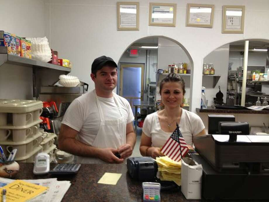 Sarah bogues/Register citizen New Hartford Diner owners, Zudi and Nizabeta Elezovsk, stand at their hopping business that opened in May.