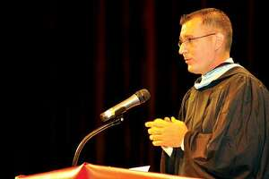 RICK THOMASON / Register CitizenTorrington School Superintendent Chris Leone speaks at Torrington High School's Class of 2011 graduation on June 19. Leone has tendered his resignation to take a position with the Bloomfield School District.
