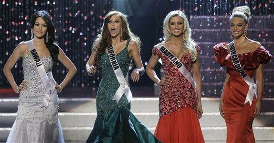 Alyssa Campanella, Miss California, second from left, reacts after being announced as a finalist during the 2011 Miss USA pageant, Sunday, June 19, 2011, in Las Vegas.  (AP Photo/Julie Jacobson) Photo: ASSOCIATED PRESS / AP2011