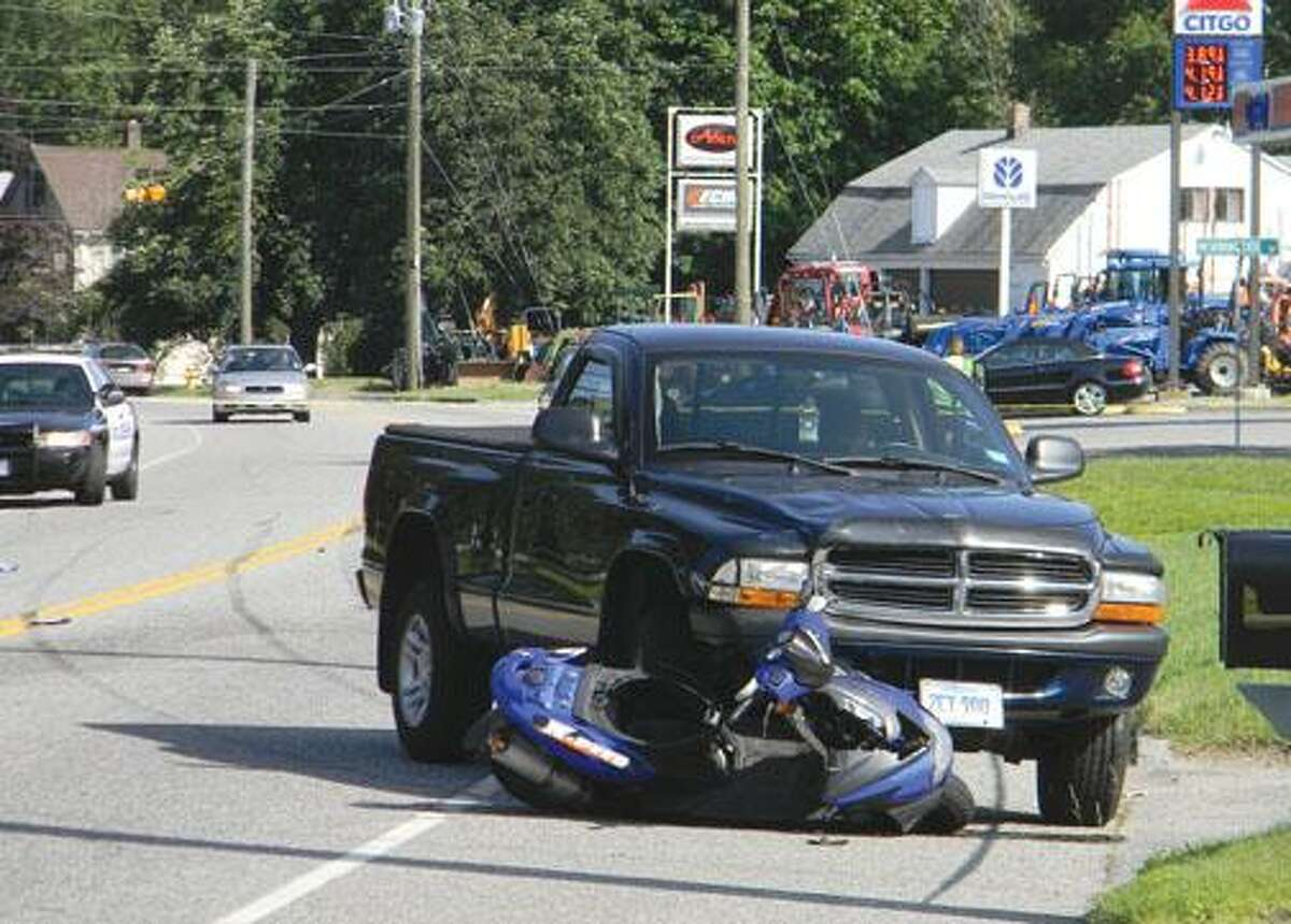 MIKE AGOGLIATI / Register Citizen A section of New Harwinton Road sits closed Monday afternoon after a two-vehicle accident involving a Dodge pickup truck and a scooter. The driver of the scooter, Bertrand Theroux of Torrington, died as a result of injuries suffered in the accident.