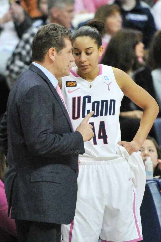 ASSOCIATED PRESS Connecticut head coach Geno Auriemma, left, gives instructions to Bria Hartley during the second half of a Feb. 11 game against Georgetown at Gampel Pavilion in Storrs. The Huskies go for 100 straight home wins on Saturday against St. John's.