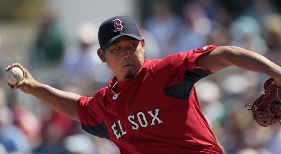 Boston Red Sox pitcher Daisuke Matsuzaka pitches in the second inning of their Grapefruit League spring training season baseball game against the Minnesota Twins at City of Palms Stadium in Fort Myers, Fla., Monday, Feb. 28, 2011. (AP Photo/Dave Martin) Photo: ASSOCIATED PRESS / AP2011