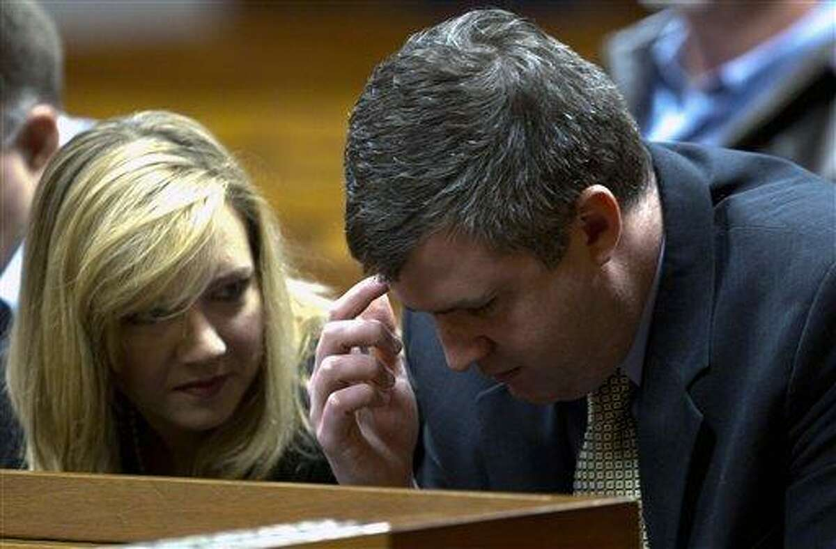 Gabe Watson talks with his wife, Kim, after arriving at the Jefferson County Courthouse in Birmingham, Ala., Monday for jury selection in his trial. Watson is accused of drowning his first wife, Tina Thomas Watson, during a scuba dive in Australia in 2003. Associated Press