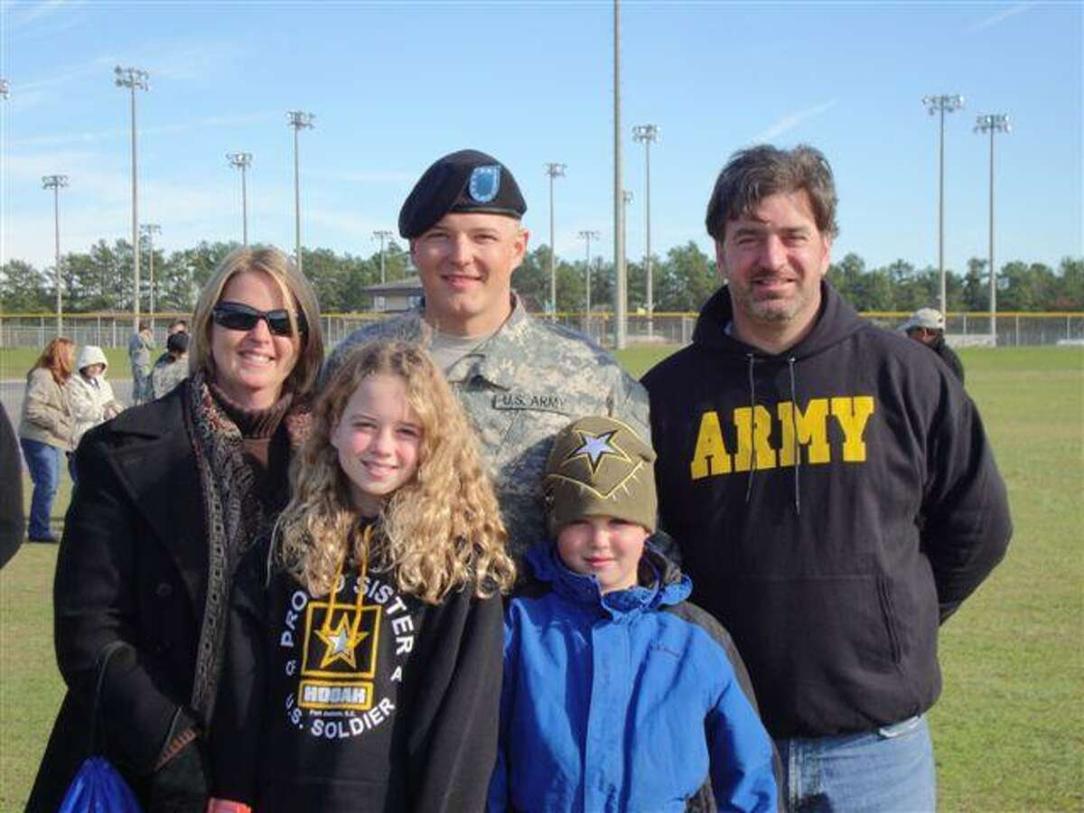 Submitted photo The family celebrates with Richard Emmons III after he completes his Army training.